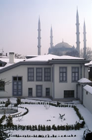 A modern view of the house of Rida Big, the residence of Bahá'u'lláh in Adrianople for one year. The Mosque of Sultan Salim is in the background.