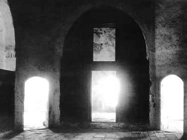 A view of some of the cells that were occupied by the exiles. The room of Bahá'u'lláh is on the left.