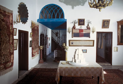 The main hall in the House of 'Abbúd, now decorated with historical items.