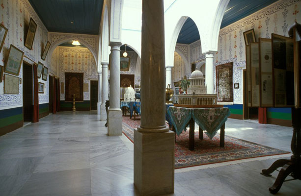 The central hall of the upper floor of the Mansion at Bahjí. After the mansion was restored in the 1930s, the furnishings were put in place by Shoghi Effendi, the great-grandson of Bahá'u'lláh and Guardian of the Bahá'í Faith.