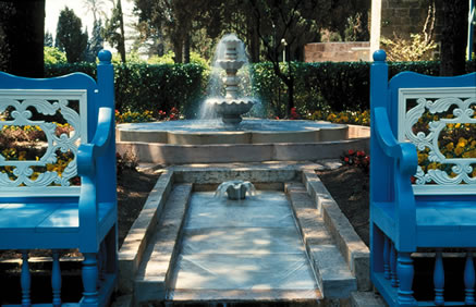 Recent view of the fountain and benches in the Ridván Garden.