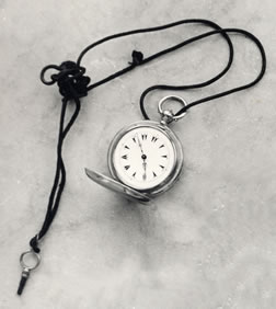 Pocket watch, watch cord and fob belonging to Bahá'u'lláh.